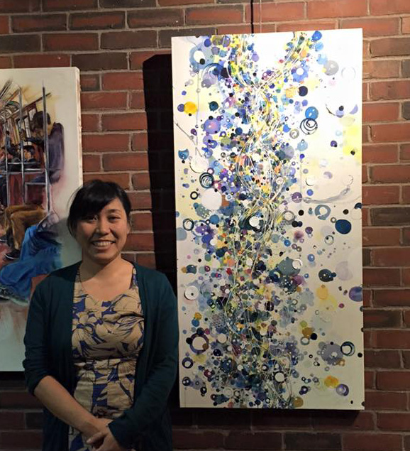 Chie showing her art at a gallery in Boston, MA.